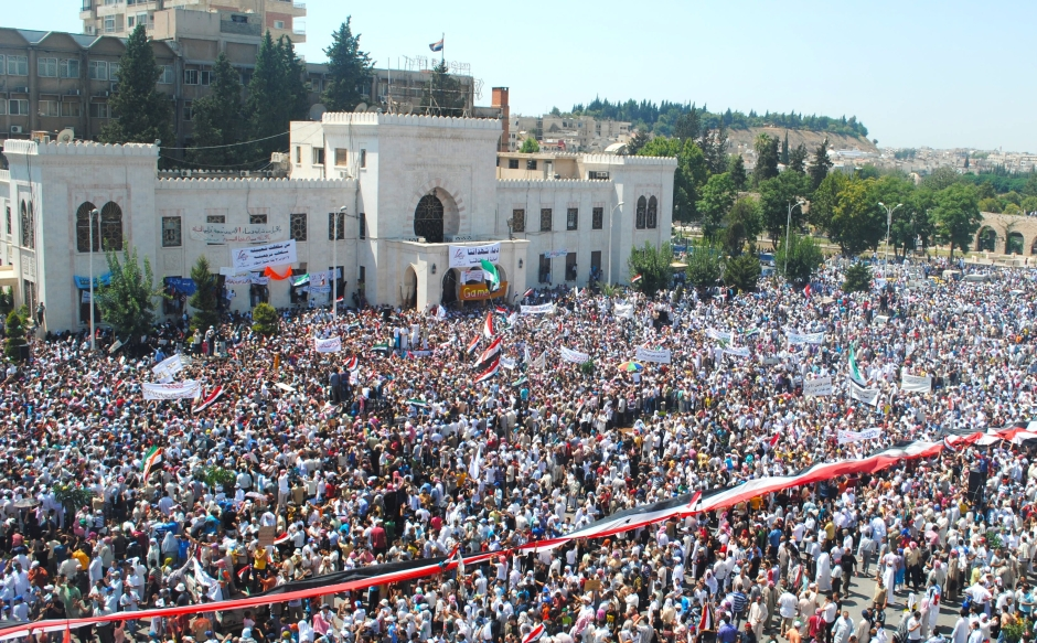 a-large-crowd-protests-in-syrian-town-of-hama-data.jpg